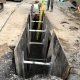 Drywell sump roadway project underway by Duke Construction excavation equipment
