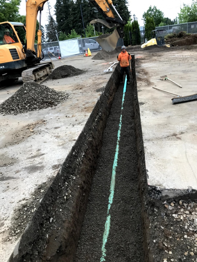 Tualatin Service Center excavation project in progress installing commercial sanitary line and concrete slab foundation for office building